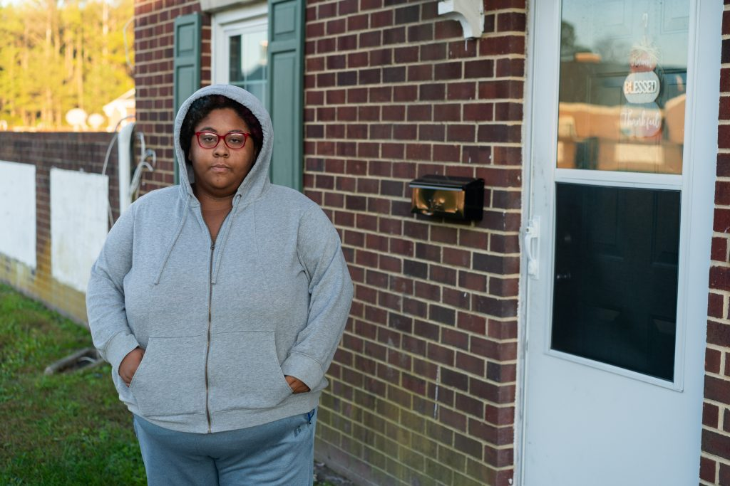 Tawna Thomas, 26, stands in front of her house owned by the Housing Authority of Crisfield in Somerset County, Maryland, on Nov. 7. Thomas said she has struggled to pay her $138 monthly rent during the pandemic and worries she might receive an eviction notice soon. (Nick McMillan/Howard Center)